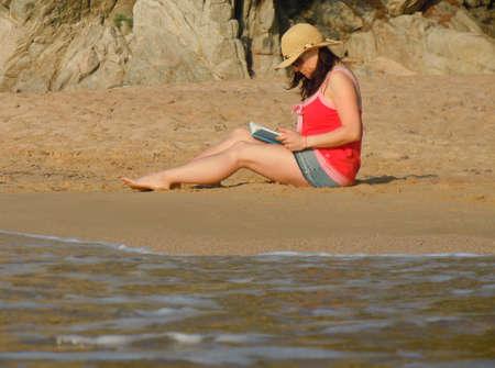 reading on the beach photo