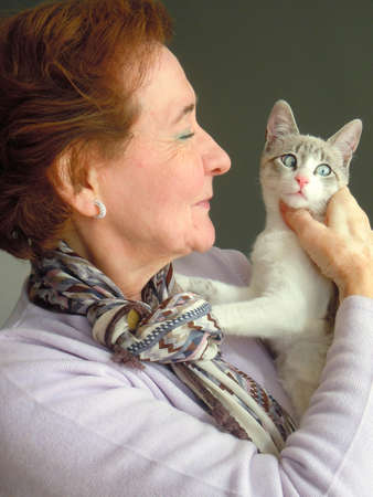 meow: portrait of senior woman and her cat Stock Photo