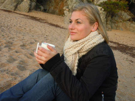 having a break: enjoying a coffee at the beach