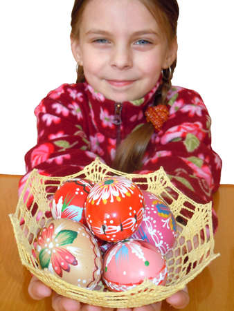 young girl holding a basket of hand painted easter eggs photo