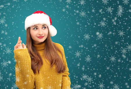 hi hat: Girl in santa hat greeting; Girl in knitted sweater; Xmas greetings;blue backrouns with snow isolated