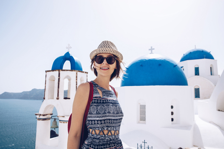 Travel Tourist Happy Woman  Santorini, Greek Islands, Greece, Europe. Girl on summer vacation visiting famous tourist destination having fun  in Oia.