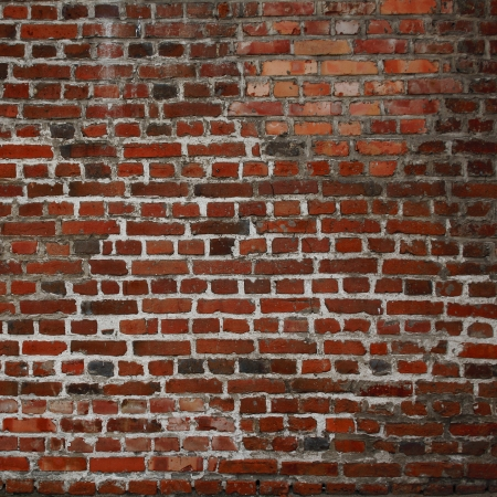 vignetted: red brick wall texture grunge background Stock Photo