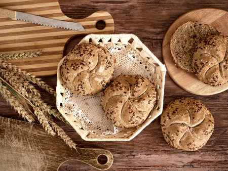 Traditional multigrain kaiser rolls with sesame seeds and flax seeds. Freshly baked bread from Poland.