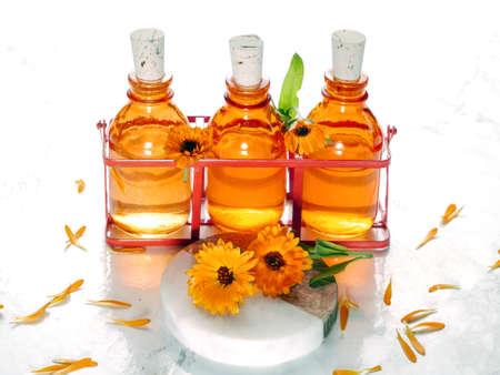 Calendula hydrosol for cleans, softens, stills and heals skin. Eco friendly body care. Фото со стока