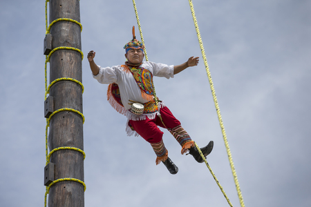 high winds: Tulum, Mexico, March 15th, 2017: ritual ceremony of the Voladores (Flying Men) Editorial