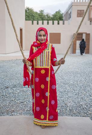 Muscat, Oman, February 4th, 2017: young omani girl on a swing Redakční
