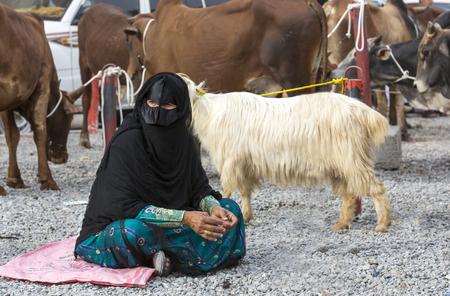 oma: Nizwa, Oma, 24th March, 2017: omani woman at a goat market Editorial