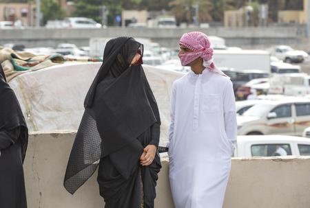 oma: Nizwa, Oma, 24th March, 2017: omani couple talking at the Nizwa market