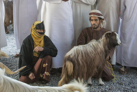 oma: Nizwa, Oma, 24th March, 2017: omani couple with a goat at a market Editorial