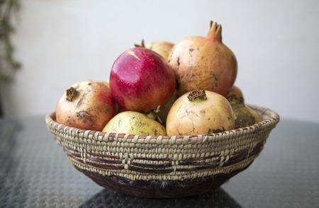Jabal al Akhdar pomegranates in a traditional omani basket Stock Photo