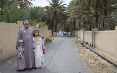 Nizwa, Oman - June 26th 2017: omani family dressed for Eid al Fitr day, that is celebrated at the end of Holy month of Ramadan Sajtókép