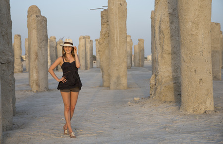 young woman in a middle of concrete pilings at a development site in Dubai