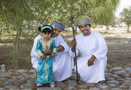 Nizwa, Oman - June 26th 2017: omani family dressed for Eid al Fitr day, that is celebrated at the end of Holy month of Ramadan Editorial