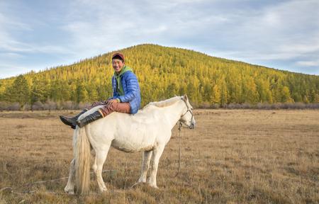 mongolian man sitting on a horse