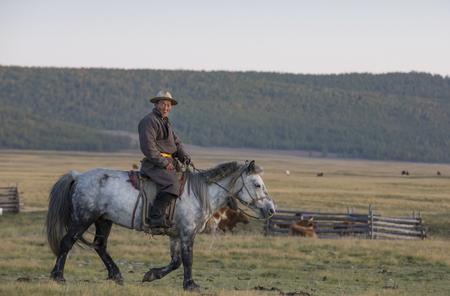 huvsgul, Mongolia, September 12th, 2017: mongolian man riding his horse at sunset Editorial