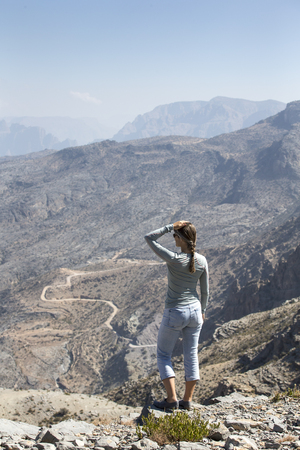 middle aged woman in the mountains in Oman Stock Photo