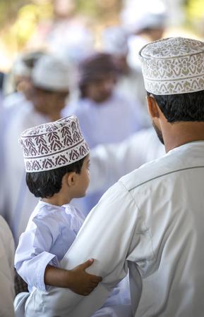 Nizwa, Oman, 10th Nobember 2017: omani man with his young son at a market