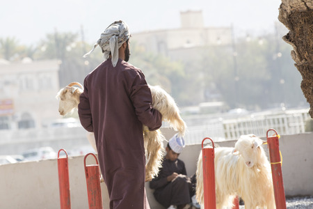 Nizwa, Oman, 10th Nobember 2017: omani people at a goat market Editorial