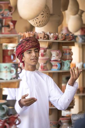 Nizwa, Oman, November 10th, 2017: omani boy dressed in traditional cloting, singing Editorial