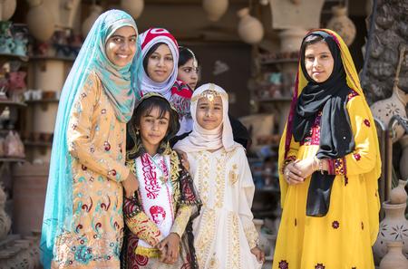 Nizwa, Oman, November 10th, 2017: omani girls dressed in traditional cloting