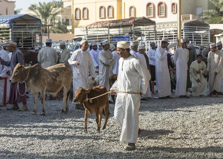 Nizwa, Oman, 10th Nobember 2017: omani people at a goat market Editorial