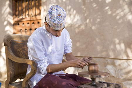 Nizwa, Oman, December 1st, 2017: omani man making pottery