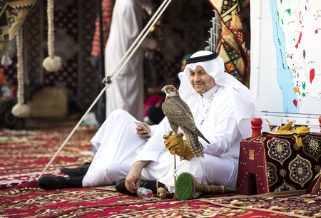 Abu Dhabi, United Arab Emirates, December 8th, 2017: emirati man with his falcon at a Falconry festival