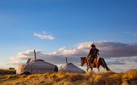 Bayan Ulgii, Mongolia, September 30th, 2015: Mongolian eagle hunter with his eagle and horse