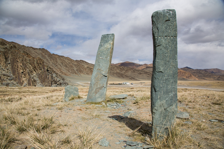 Ancient burual Stones in a Landscape of Western Mongolia Stock Photo