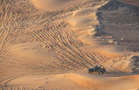 car driving in a Desert at the fossil rock near Dubai, United Arab Emirates