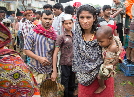Chittagong, Bangladesh, 7th March, 2016: mother with her baby at a market Editorial