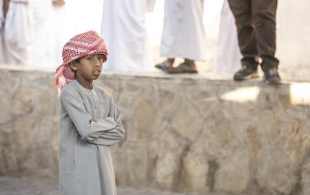 Nizwa, Oman, Febrary 2nd, 2018: young  omani man at a market Editorial