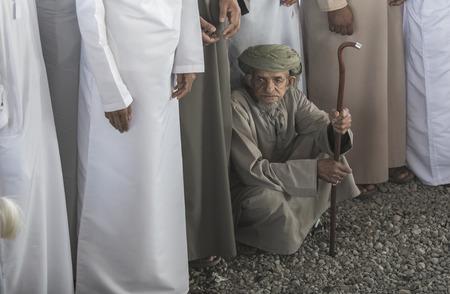 Nizwa, Oman, Febrary 2nd, 2018: old omani man at a market