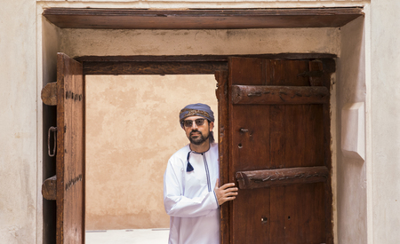 Arab man in traditional Omani outfit in an old castle