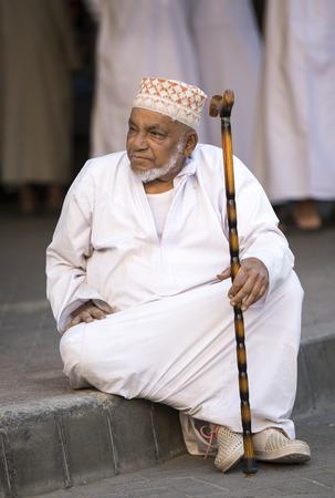 nizwa, Oman, Febrary 2nd, 2018: old omani man resting at a market