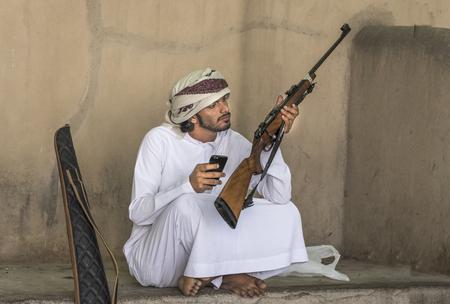 Nizwa, Oman, Febrary 2nd, 2018: omani man with a hunting rifle at a market
