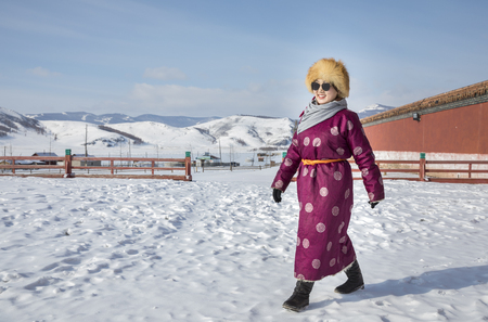Hatgal, Mongolia, 1st March 2018: mongolian woman walking in a snow