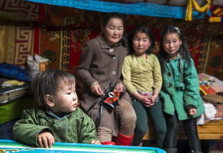 Hatgal, Mongolia, 3rd March 2018: mongolian kids in in their home ger Editorial