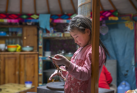 Hatgal, Mongolia, 2nd March 2018: mongolian girl inside her home ger