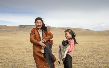 Hatgal, Mongolia, 2nd March 2018: mongolian girls having fun in a steppe Editorial