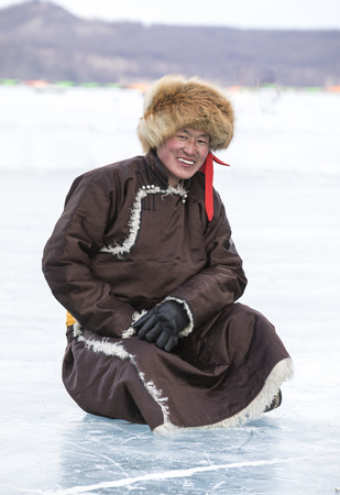 Hatgal, Mongolia, 4th March 2018: mongolian man dressed in traditional clothing on a frozen lake Khuvsgul Editorial