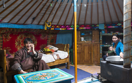 Hatgal, Mongolia, 3rd March 2018: mongolian family in their home ger, mother breastfeeding her baby Editorial