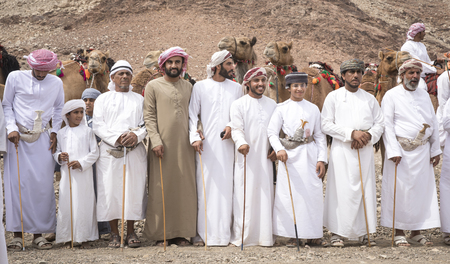Khadal, Oman, 7th April, 2018: omani men dressed up and getting ready to race their camels