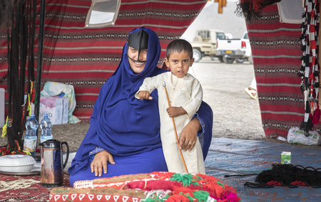Ibri, Oman, 28th April 2018: bedouin woman with her kid in a tent Editorial
