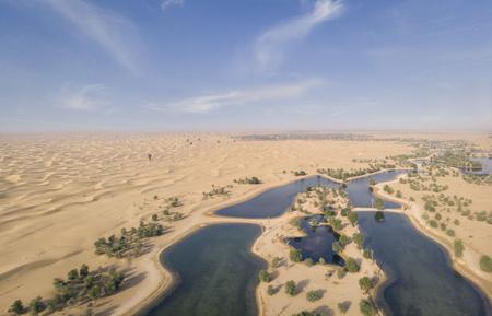 aerial view of Al Qudra Lakes in a desert near Dubai