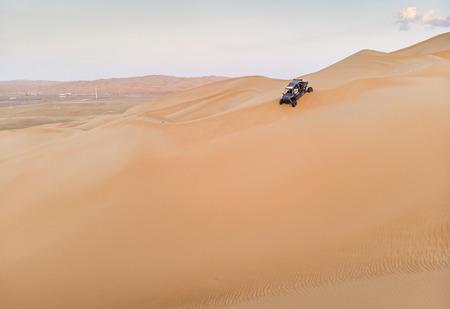 aerial view of a dune buggy in Liwa desert in Abu Dhabi