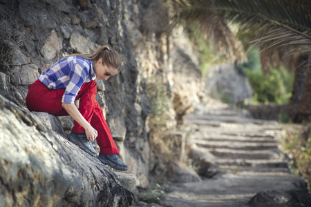 hiker in an old omani garden
