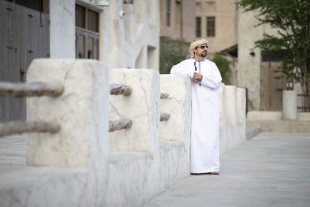 arab man in old Al Seef part of Dubai, United Arab Emirates Stock Photo