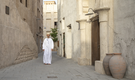 arab manw waling in old Al Seef part of Dubai, United Arab Emirates